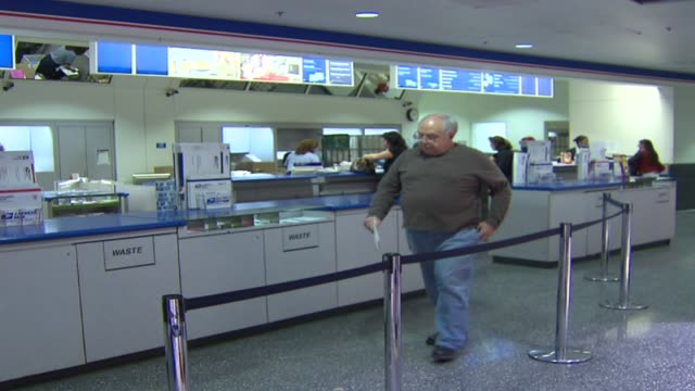 counter at post office on december 22, 2009 in chicago, illinois - united states postal service stock videos & royalty-free footage