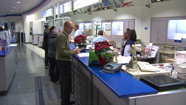counter at the post office on december 09 2013 in chicago illinois - post office stock videos & royalty-free footage