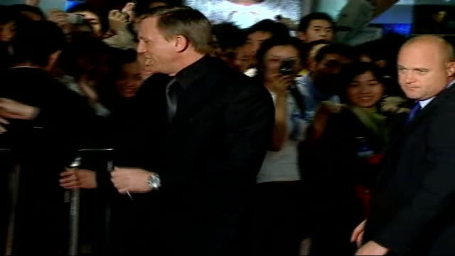 counterfeit economy booming; china: beijing: ext/night daniel craig on the red carpet greeting fans at chinese premiere of 'casino royale' **some... - première stock videos & royalty-free footage