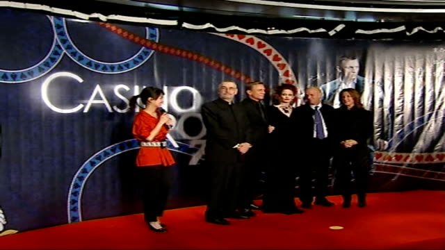 Counterfeit economy booming **flash photography** 'Casino Royale' personnel including Eva Green Daniel Craig and Martin Campbell posing on stage for...