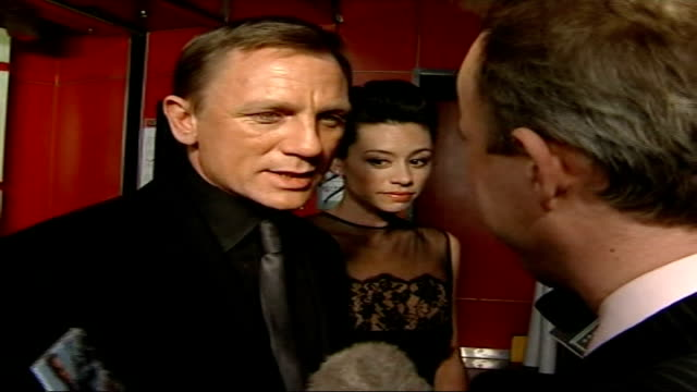 counterfeit economy booming int daniel craig standing next to girlfriend producer satsuki mitchell as interviewed sot it's a shame but that's the way... - satsuki mitchell stock videos and b-roll footage