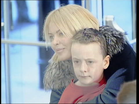 Counterfeit goods/ Harry Potter pirate video London Leicester Square Odeon Actress Patsy Kensit and son James arriving for premiere of 'Harry Potter...