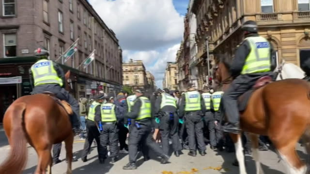counterprotestors being held back from antiracism protesters by a police line in glasgow - anti racism stock videos & royalty-free footage