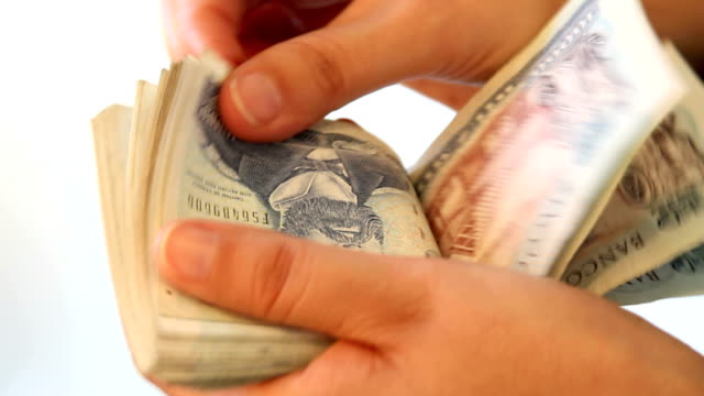 counting chilean money - home finances stock videos & royalty-free footage