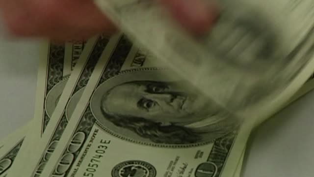 counting dollars - banknote stock videos & royalty-free footage