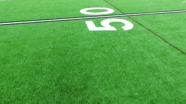 counting down yard lines close to green astro turf football field perfect close angle - football goal post stock videos and b-roll footage