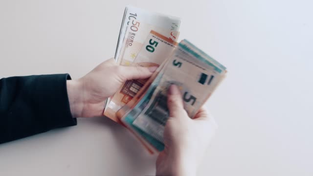 counting euro banknotes by hand - euro symbol stock videos and b-roll footage