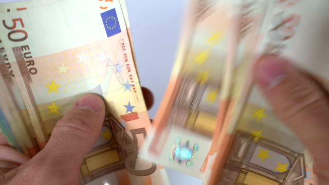 counting euro euro banknotes - euro symbol stock videos and b-roll footage