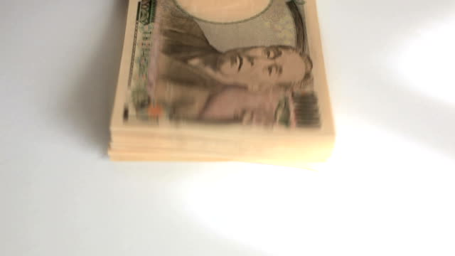 counting japanese yen. - plusphoto stock videos & royalty-free footage