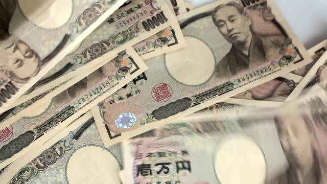 vídeos y material grabado en eventos de stock de recuento de yen japonés. - ganar dinero
