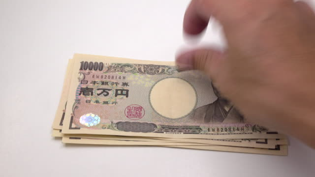 counting japanese yen - yen sign stock videos & royalty-free footage