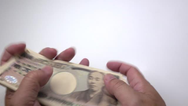 vidéos et rushes de comptant yen japonais - symbole du yen