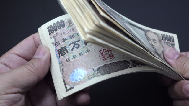 計数日本円 - 紙幣点の映像素材/bロール
