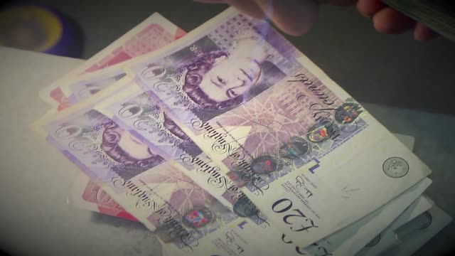 counting money - british pounds - pound sterling symbol stock videos & royalty-free footage