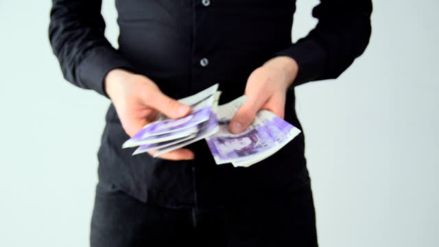 counting money - british pounds - counting stock videos & royalty-free footage