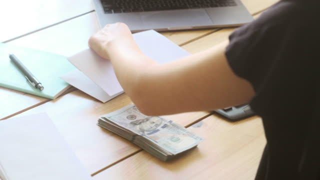 counting money - envelope stock videos & royalty-free footage