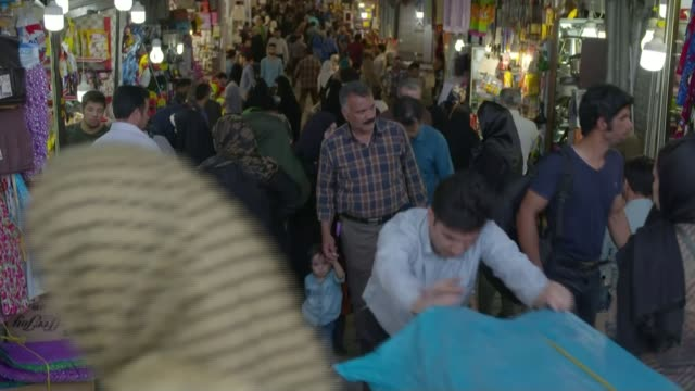 Countries say they will stand by nuclear deal despite Trump threats to end it T17051721 / 1752017 Tehran Man pulling cart along through Grand Bazaar...