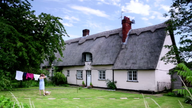 country cottage... - thatched roof stock videos & royalty-free footage