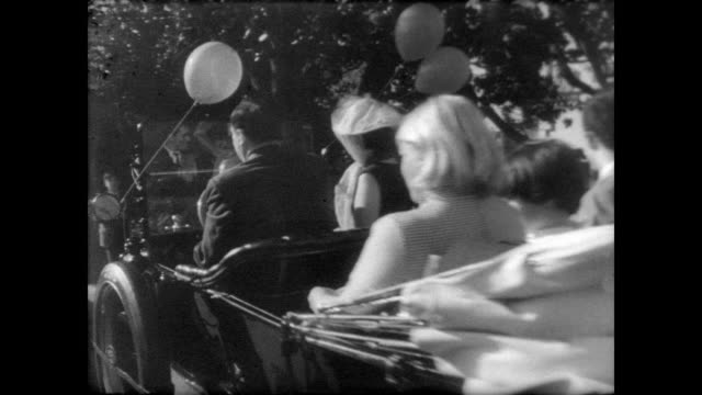 country fair with carnival rides on south lawn of white house / president johnson shakes hands with children and guests / lady bird johnson and vice... - president stock videos & royalty-free footage