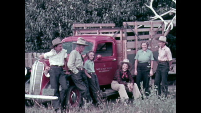 a country family by their pick up truck pose for a photo. - american culture stock videos & royalty-free footage