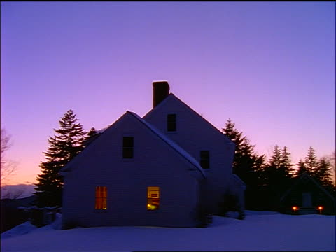 stockvideo's en b-roll-footage met country house with lights in windows in snow / dusk - 1990