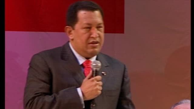 country in mourning after death of president hugo chavez tx chavez supporters at rally hugo chavez speaking on stage sot ends - ウゴ・チャベス点の映像素材/bロール