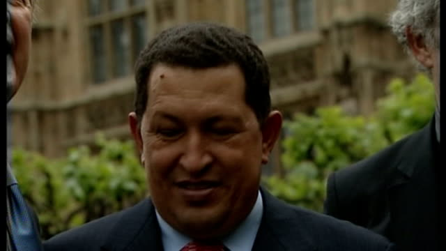 country in mourning after death of president hugo chavez tx london westminster photography *** chavez posing for photocall with group of mps - ウゴ・チャベス点の映像素材/bロール