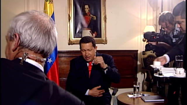 country in mourning after death of president hugo chavez tx london int chavez sitting for interview as sings love song in spanish before interview... - ウゴ・チャベス点の映像素材/bロール