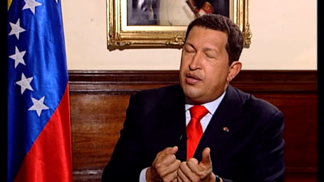 country in mourning after death of president hugo chavez tx london chavez interview sot - ウゴ・チャベス点の映像素材/bロール