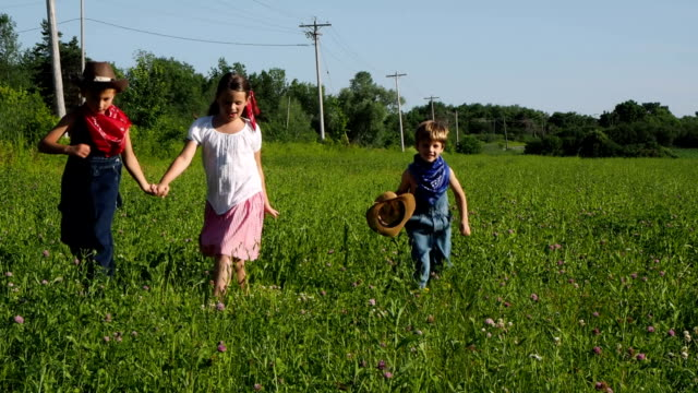 country kids on farm - cowboy hat stock videos & royalty-free footage