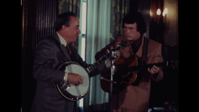 country music musician earl scruggs preforms with his son randy scruggs and another man at an event in nashville tennessee - bluegrass music stock videos and b-roll footage