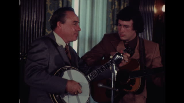 country musician earl scruggs performs with his son randy scruggs and another man at event in nashville tennessee - bluegrass music stock videos and b-roll footage