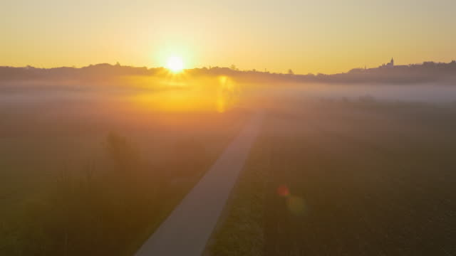 aerial country road at sunrise - horizon over land stock videos & royalty-free footage