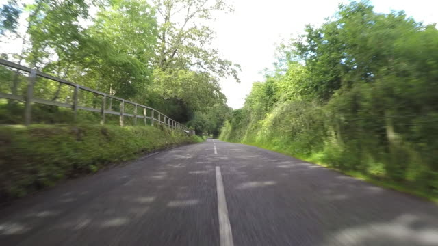 country road driving pov - car point of view stock videos & royalty-free footage