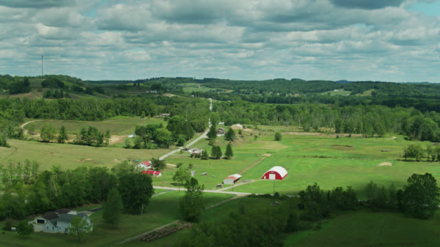 country road in greene county, pa - aerial - community stock videos & royalty-free footage