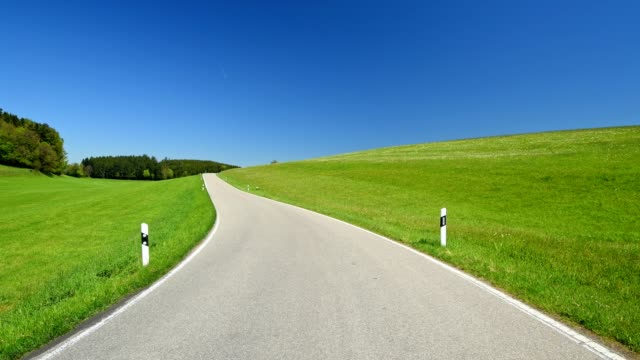 country road in meadow landscape in spring, baden-wurttemberg, germany - baden wurttemberg stock videos and b-roll footage