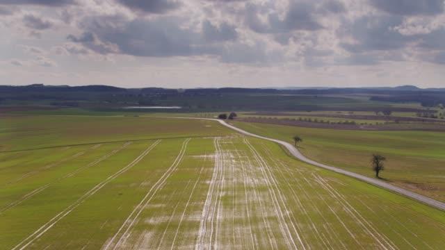 vidéos et rushes de route de campagne en moselle, lorraine - vue aérienne - route de campagne