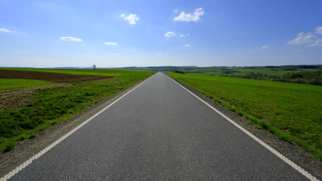 country road in spring, vogelsberg district, hesse, germany - horizon over land stock videos & royalty-free footage