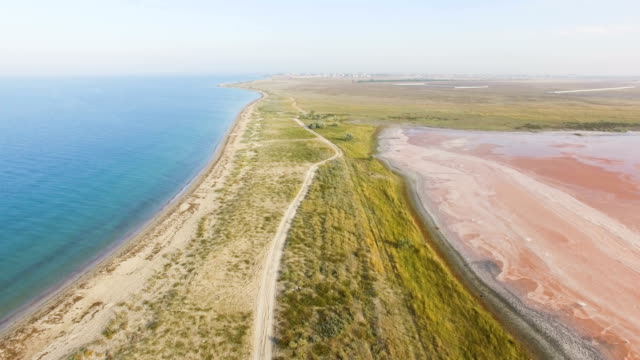 AERIAL: Country road nearby seashore
