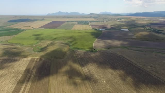 country road through agricultural fields, aerial video - chiaroscuro stock videos and b-roll footage