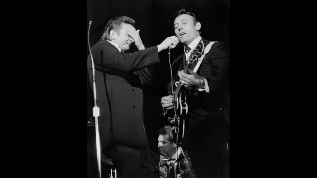 gif country singer/songwriter johnny cash performs onstage with guitarist carl perkins in 1968 in los angeles california - johnny cash stock videos & royalty-free footage