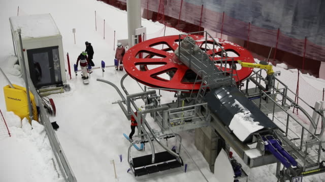 a country that's symbolic of mountains snow and winter sports adapts to a warming world with its first indoorskiing center the sno indoor skiing... - ski lift stock videos & royalty-free footage