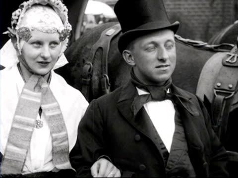 vidéos et rushes de country wedding in traditional dutch costume / friesland, netherlands - 1928