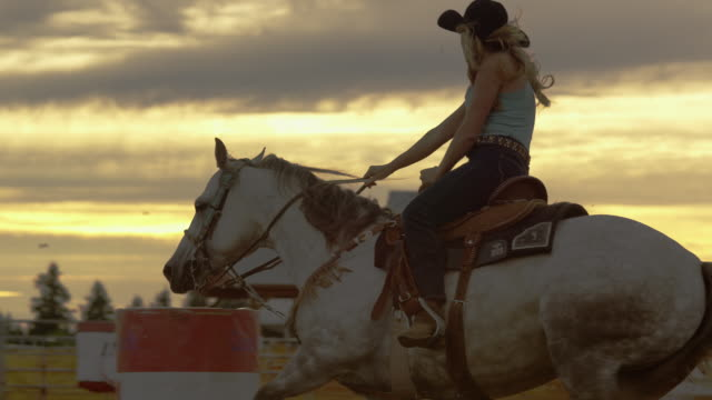 country woman races horse - cowgirl stock videos & royalty-free footage