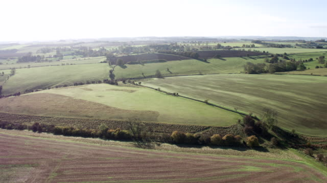 countryside aerial - plowed field stock videos & royalty-free footage