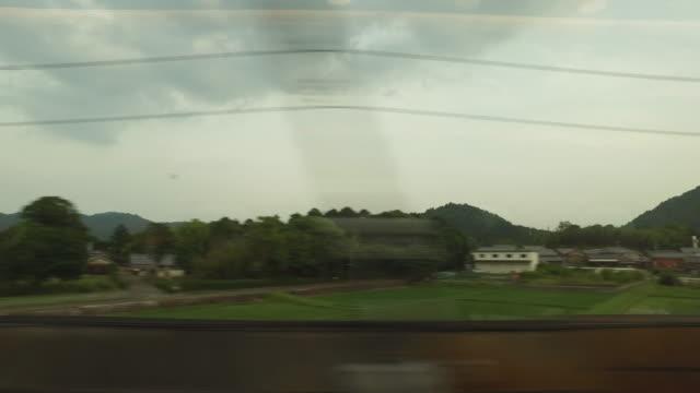 列車の窓から田舎 - 内部点の映像素材/bロール