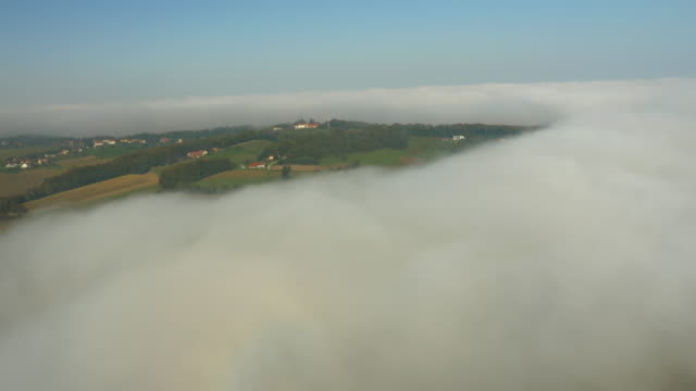 aerial countryside in the fog - prekmurje stock videos & royalty-free footage