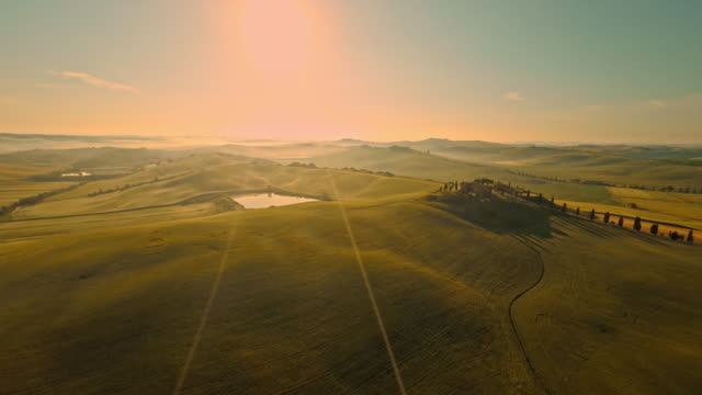 aerial countryside in tuscany at sunset - twilight stock videos & royalty-free footage
