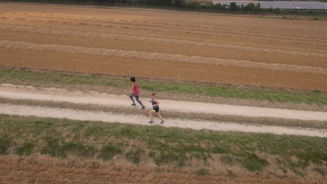 countryside joggers - drone pilot stock videos and b-roll footage
