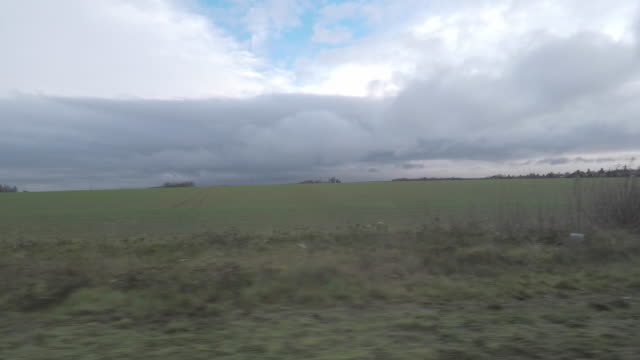 countryside landscape seen from car - overcast stock videos & royalty-free footage